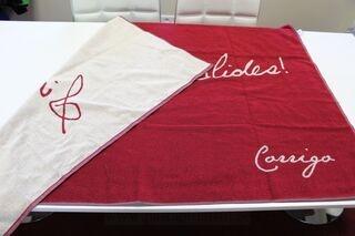 Kootud logoa rätik